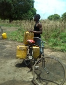 A man at Mtwara region collecting water on bike
