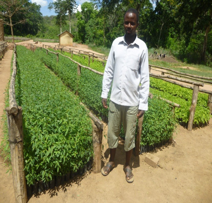 a man posing at Rondo tree planting project, African Palms