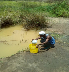 A man at Mtwara region collecting water
