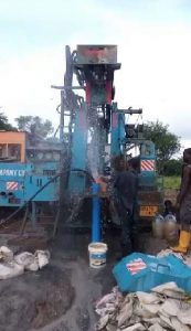 Drilling the bore hole in Murumba Village project partly funded by African Palms selling palm crosses