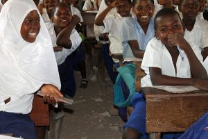 pupils of Mkuti primary in a happy mood after receiving books, project funded by African Palms selling palm crosses