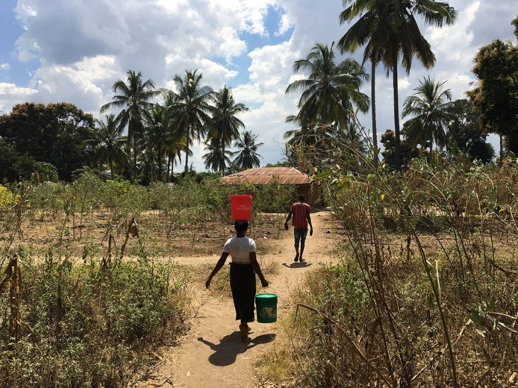 carrying at water a much shorter distante point pipeline at Chipinpinbi project funded-by  African Palms-selling palm crosses