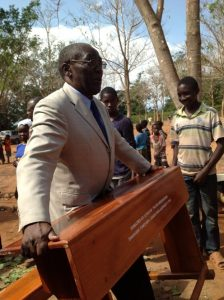 Desk arriving at Masasi village, project funded by African Palms selling palm crosses