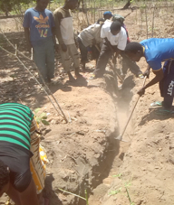 Digging Trench for the pipeline at Miungo water project, funded by African Palms, selling palm crosses