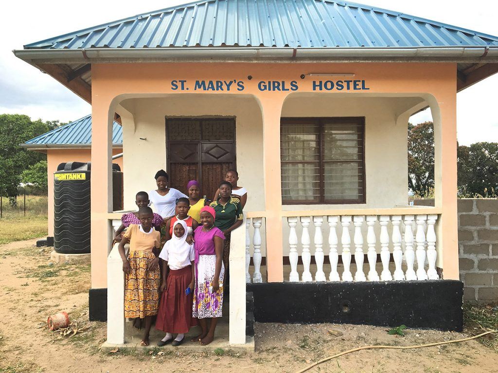 girls standing outside the hostel project funded by African Palms selling palm crosses