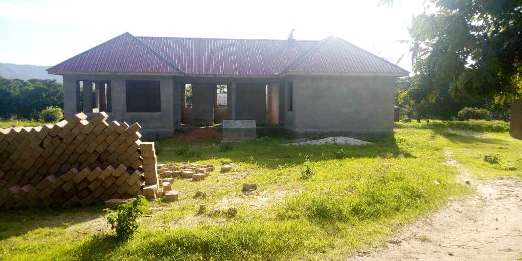 New building of Chidya health centre at south Tanzania, for Masasi people, project funded by African Palms, selling palm crosses