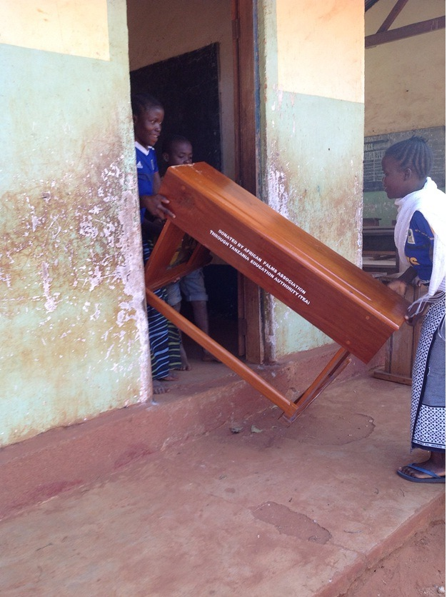 taking the desks into school for Masasi Villages project  funded by African Palms selling palm crosses