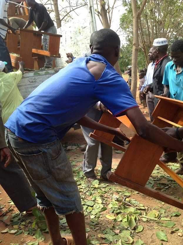 unloading desks for Masasi Villages project  funded by African Palms selling palm crosses